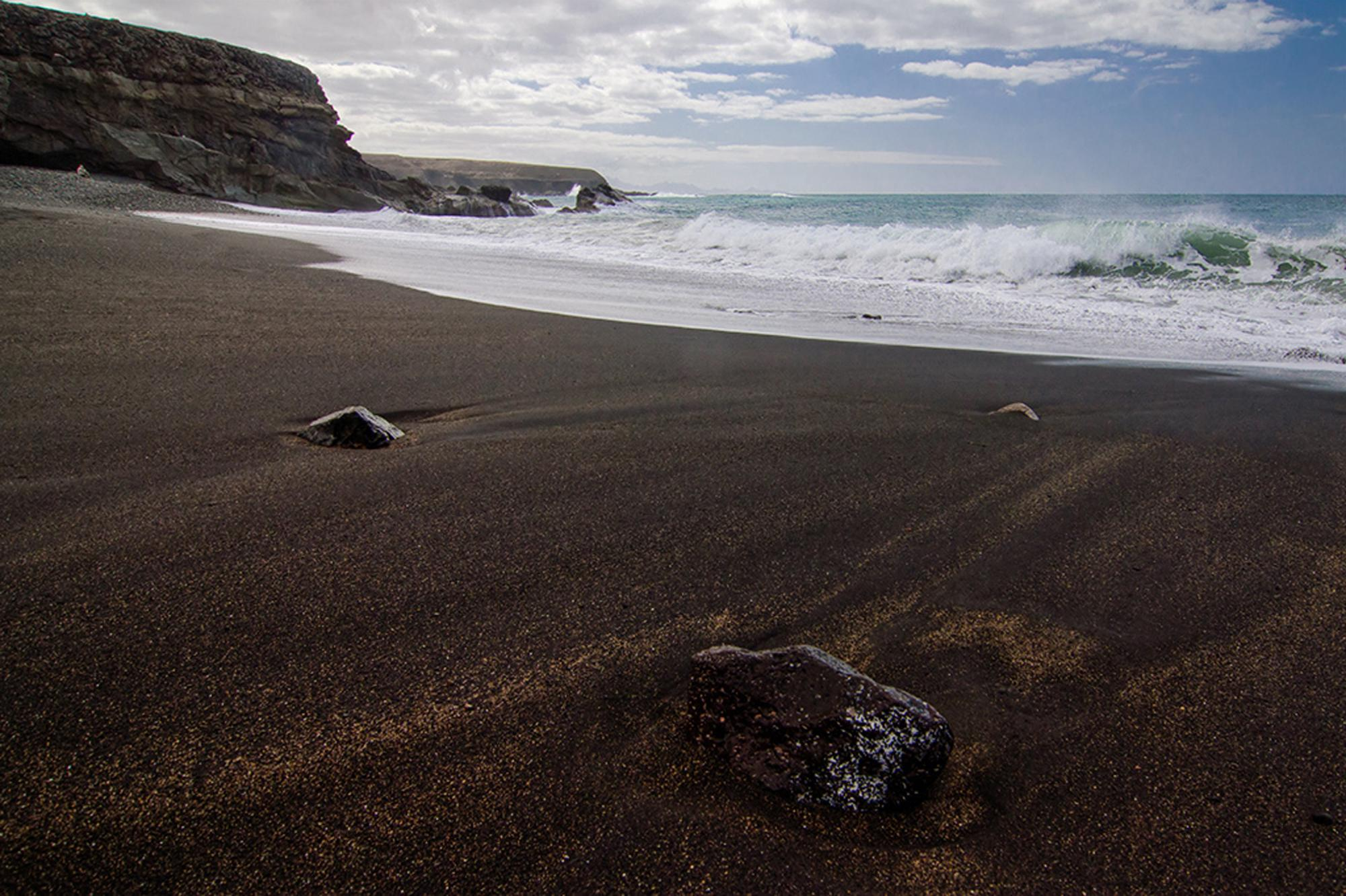 100 beach black sand black sand beach in madeira stock phot